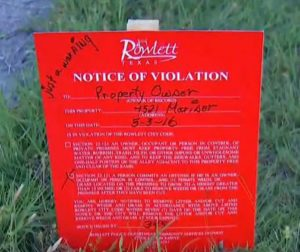 exas City Stakes Threatening Signs In Yards of Tornado Victims For Grass Being To High