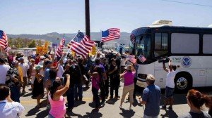 US protesters  block the arrival of immigrant detainees who were scheduled to be processed at the Murrieta Border Patrol station in California. - courtesy of NPR