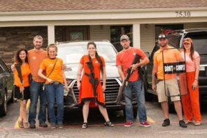 The DC Crew Wearing Orange